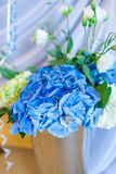 Bouquet of white and blue flower in metal vase Stock Images