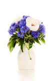 A bouquet of white and blue flowers in a vase Royalty Free Stock Images