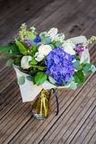 Bouquet of white and blue spring flowers Stock Photos