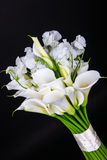 Bouquet of white calla lilies and eustoma on black background Royalty Free Stock Photos
