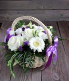 Bouquet of white  eustoma, roses and chrysanthemums in basket Royalty Free Stock Photography