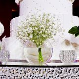Bouquet of white  flowers in a glass vase Royalty Free Stock Photos