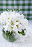 Bouquet of white flowers on the kitchen table Royalty Free Stock Images