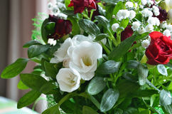 Bouquet of white flowers and small roses. Bouquet of white flowers and small red roses Royalty Free Stock Image