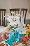 Bouquet from white flowers on a table 1759. Stock Photos