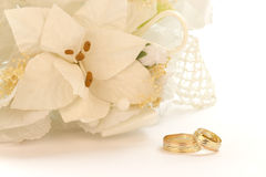 Bouquet of white flowers with wedding rings Stock Images