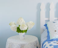 Bouquet of white hydrangea flowers on a site bed table in a coun Royalty Free Stock Photography