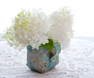 Bouquet of white hydrangea flowers on a table. Royalty Free Stock Photography