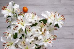 Bouquet of white lilies on the background of the floor stock photography