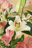 Bouquet with a white lily Royalty Free Stock Photos
