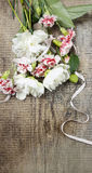 Bouquet of white peonies and pink carnations royalty free stock image