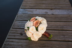 A bouquet of white and pink roses on   wooden pier Stock Images