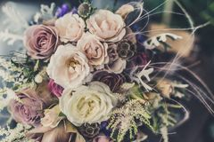 Bouquet of white and purple roses stock image