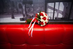 Bouquet of white and red roses on the couch Royalty Free Stock Photography
