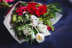 Bouquet of white and red tulips on a blue textile. Bouquet of white and red tulips lies on a blue textile Stock Photo