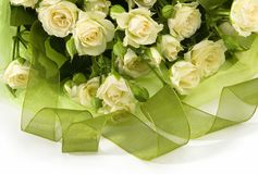 Bouquet from white roses. Wedding bouquet from beautiful white roses with green tape Royalty Free Stock Photography