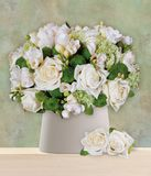 A bouquet of white roses arranged in the vase royalty free stock photos