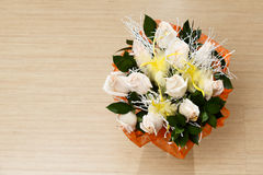Bouquet of white roses on the floor. Bouquet of white roses on the wooden floor Royalty Free Stock Image