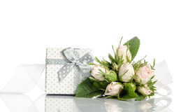 Bouquet of white roses and gift box Stock Photography