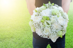Bouquet of white roses in hand Royalty Free Stock Photo