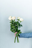 Bouquet of white roses in hands. Valentine`s day Royalty Free Stock Photos