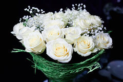 A bouquet of white roses. On a table in a beautiful package Royalty Free Stock Photo