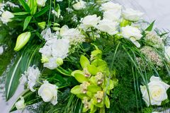 Big bouquet of white roses, yellow daffodils, greenery and lotuses Stock Photography