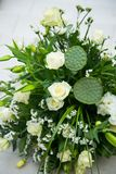 Big bouquet of white roses, yellow daffodils, greenery and lotuses Royalty Free Stock Photography