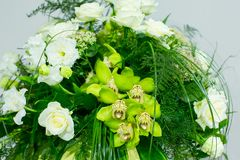 Big bouquet of white roses, yellow daffodils, greenery and lotuses Stock Photos