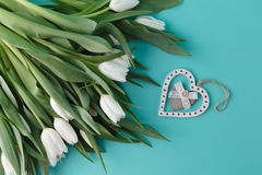 Bouquet of white spring tulips on plain aquamarine background Stock Images