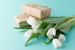 Bouquet of white spring tulips on plain aquamarine background Royalty Free Stock Photography