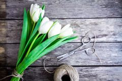 Bouquet of white tulips on a rustic background Royalty Free Stock Image
