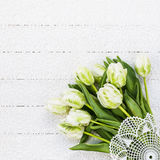 Bouquet of white tulips on white tablecloth. Top view Royalty Free Stock Photo