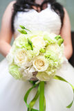 Bouquet white wedding. At the wedding, the groom will be holding the flowers to the bride, bride clasped it until the end of the wedding and then thrown to Royalty Free Stock Image