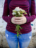 A bouquet of white wildflowers in the hands of a girl Royalty Free Stock Image