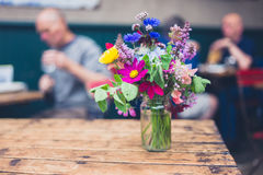 Bouquet of wild flowers in cafe Royalty Free Stock Photo