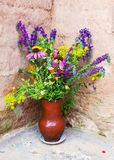 Bouquet of wild flowers in a clay jug Stock Photography