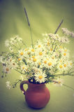 Bouquet of wild flowers in a clay pot Stock Photography