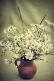 Bouquet of wild flowers in a clay pot, toning Royalty Free Stock Images