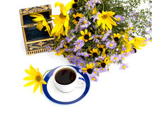 Bouquet of wild flowers, coffee and casket, top view Stock Photos