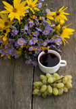 Bouquet of wild flowers, coffee and grapes, top view, still life Royalty Free Stock Photos