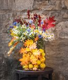 Bouquet of Wild Flowers and Colorful Autumn Leaves. royalty free stock image