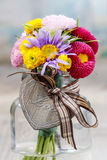 Bouquet of wild flowers in glass vase. Party decoartion Royalty Free Stock Image