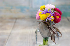 Bouquet of wild flowers in glass vase Stock Photography
