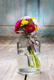 Bouquet of wild flowers in glass vase. Party decoration Stock Photos
