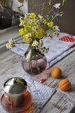 Bouquet of wild flowers in a glass vase. Still life: bouquet of wild flowers on the kitchen table Stock Images