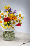 Bouquet of wild flowers on gray Royalty Free Stock Photos