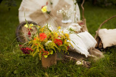 Bouquet of wild flowers, linen fabric, decoupage wheel and jars Stock Photography