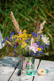 Bouquet of wild flowers in a metal cup with floats Stock Image