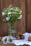 Bouquet of wild flowers in the style of Provence with nuts Royalty Free Stock Photos